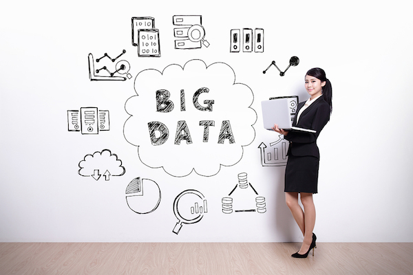 Big Data concept - business woman using laptop computer with hand drawing Big Data concept background